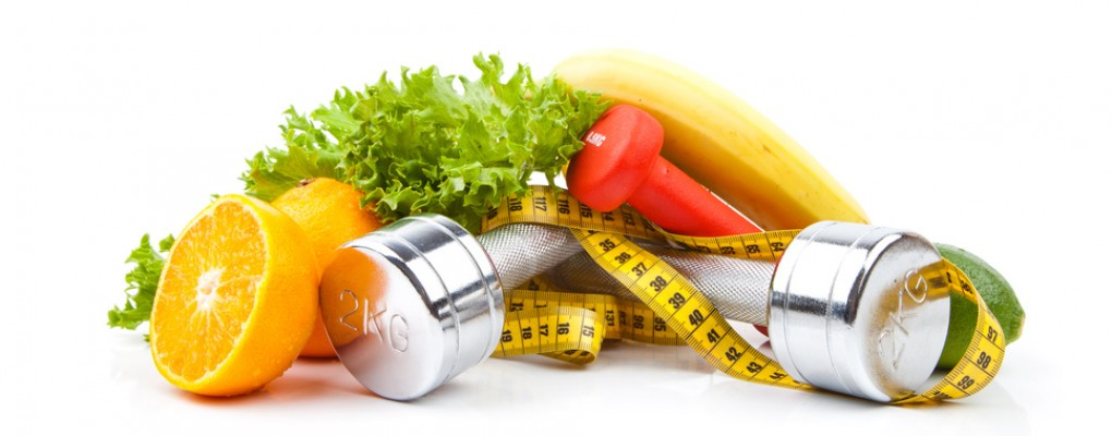 fitness dumbbells, fruits and measure tape